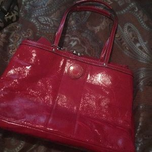Coach red bag pink interior. Never used.